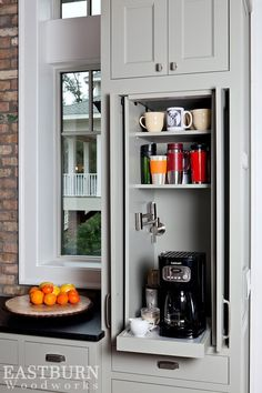 Built in pull out coffee bar with shaker doors