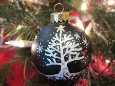paint pens and glass ball ornaments