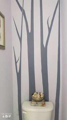 Once I got the idea in my head to paint tall birch-like trees in my powder room, I just couldn't shake it. My powder room is very small and the ceilings are ver… Blue Powder Rooms, Modern Powder Rooms, Osborne And Little Wallpaper, Diy Wallpaper, Birch Tree Mural, Powder Room Design, Favorite Paint Colors, House Painting, Room Inspiration