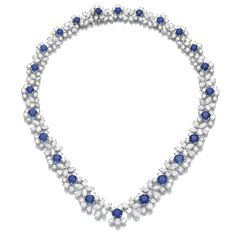 Sapphire and diamond necklace, Harry Winston. Set with graduated circular-cut sapphires within a cluster of pear-, marquise-shaped and brilliant-cut diamonds, length approximately 435mm, signed Harry Winston, numbered.