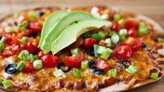 Mexican Flatbread Pizzas   Ingredients 4 flatbreads 1/4 cup Old El Paso™ Mild Thick 'n Chunky salsa 1 cup shredded Colby-Monterey Jack cheese blend (4 oz) 1/2 cup sliced ripe olives 1 cup chopped or quartered cherry tomatoes 1/2 cup sliced green onions 1 avocado, pitted, peeled and sliced Directions Heat oven to 400°F. Place flatbreads on ungreased cookie sheet. Spread 1 tablespoon salsa over each flatbread. Sprinkle evenly with cheese and olives. Bake 8 to 10 minutes or until cheese is…