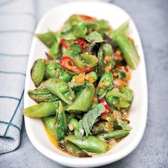 Sugar Snap Peas with Soffrito, Hot Pepper and Mint - Quick Side Dishes on Food & Wine Mint Recipes, Pea Recipes, Spring Recipes, Side Dish Recipes, Vegetarian Recipes, Yummy Recipes, Snap Peas Recipe, Summer Vegetable Recipes, Creamy Potato Salad
