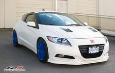 White Honda CR-Z with blue rims