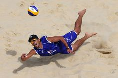 Katsuhiro Shiratori of Japan dives for a shot during the Men's Beach Volleyball preliminary match between Japan and Spain on Day 6 of the London 2012 Olympic Games at Horse Guards Parade on August 2, 2012 in London, England.