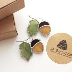 Glass Brooch Acorn is made from stained glass, copper foil and tin. This is handmade jewelry in Tiffany technique. Length 5 см (1,9 inch), width 5 см (1,9 inch). Every jewelry goes with handmade paper packaging.