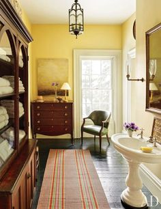 The master bath is accented by a Tom Leaver painting, and the runner is an antique Venetian stripe | archdigest.com