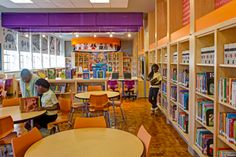 Reuse and Restoration: The Samuel Coleridge-Taylor Elementary School Library in Baltimore embraces its past with this renovation. Old elements were discarded to reveal existing historic architectural structures. Brick archways hidden behind walls now make up the entryway, and an original hardwood floor more than 100 years old now shines after being freed from a laminate cover. Renovation; JRS Architects; Photo: JSR Architects/Alain Jaramillo.