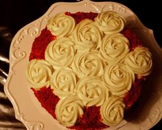 Red velvet cake with cream cheese frosting roses