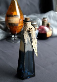 potion bottle... love the head! COOL BOTTEL