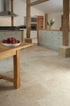 Love these floors for kitchen makeover.     contemporary country barn conversion kitchen with Tumbled Aspendos Travertine floor tiles