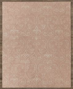RH Baby & Child's Sevilla Floral Wool Rug:Hand tufted in pure wool, this rug's lofty pile provides a plush background for meandering garden vines. Loomed in lustrous viscose, the graceful design adds a touch of tonal detail to the thick wool, and the surface is sheared to a smooth, invitingly soft finish. Hand-hemmed edges enhance the rug's handcrafted character.