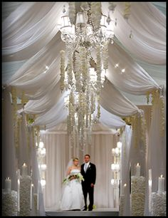 Soft white fabric billowing from the ceiling -a David Tutera creation.