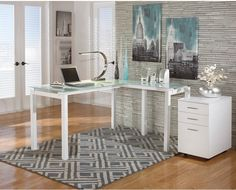 Enhance your office space by adding this metro-modern Bexley computer desk to the room. Its tempered and frosted glass desktop is strong enough to support your computer, printer and more while exuding ultra-modern style. Scratch-resistant, its white metal frame is both eye-catching and durable. Its versatile L-shape meets a wide range of set-up needs, while the generous desktop makes it easy to find space for all your home office items. Get ready to happily work the day away with Bexley at…