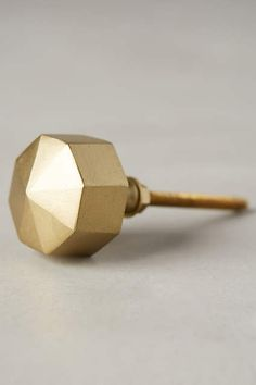 Metallic gold faceted knob found at anthropologie.com