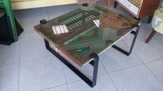 Coffee table made of old renovated wooden window shutters, glass top and metal legs. Custom-made piece, which can be modified according to preferred dimensions, colors and finishes!