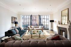 The living room in Rupert Murdoch's West Village townhouse features French doors that open onto a Juliet balcony overlooking the garden.
