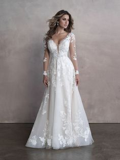 Lacy flowers trail down the illusion sleeves and bodice of this romantic a-line wedding gown. Dream Wedding Dresses, Designer Wedding Dresses, Bridal Dresses, Wedding Gowns, Bridesmaid Dresses, Prom Dresses, Boho Wedding, Fall Wedding, Allure Couture