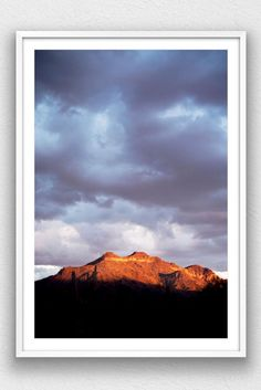 Landscape color print of storm clouds, during monsoon season, over Usery Mountain, in Arizona.