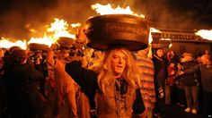 The traditional carry of flaming tar barrels in ottery St Mary England