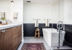 Hexagon shaped tiles are interesting Bath Gets Hexy in Black | Installation Gallery | Fireclay Tile