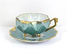 Vintage Tea Cup Royal Sealy China Japan Footed Green w/ Gold Trim and Accents. $40.00, via Etsy.
