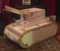 I made this cardboard army tank using gummed tape to seal the cardboard together. It's better to use gummed tape because it can be painted over. Don't have gummed tape? Click the visit button above to purchase the one I used for this project. Army Birthday Parties, Army's Birthday, Retirement Parties, Birthday Party Themes, Camouflage Party, Camo Party, Nerf Party, Army Party Decorations, Soldier Party