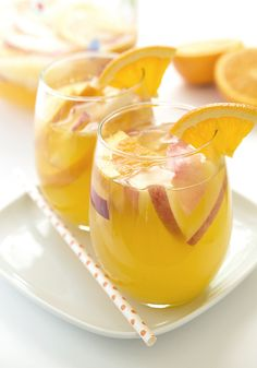 This White Wine Sangria is sure to be a crowd-pleaser. It is ready in less than 5 minutes! Made with fresh peaches, oranges, triple sec, and orange vodka. White Wine Sangria, Triple Sec, Sangria Recipes, Cocktail Recipes, Cocktail Menu, Drink Recipes, Yummy Drinks, Fun Drinks, Fast Recipes