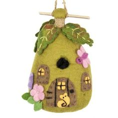 A wool felt birdhouse that birds will really nest in. But wouldn't it make a great decoration for a child's room, or a play fairy house? $25.95