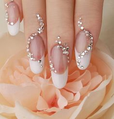 Trailing 3D rhinestones on these classic French nails. NAIL CAFE CHOCOLAT Ginza location in Tokyo http://ameblo.jp/nail-cafe-chocolat/                                                                                                                                                      もっと見る