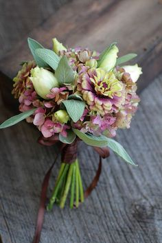 Pretty mauve, burgundy, and green bridal bouquet.