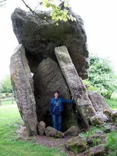 A trip participant tries to feel the age of this 6000 year old Megalithic tomb in the southern Ireland.