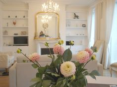 Serene white shabby chic living room/fireplace with gilded mirror/built in shelves/Nordic French apartment in Paris we rented/Hello Lovely Studio/fresh flowers Paris Apartment Interiors, Paris Apartments, Apartment Interior Design, French Apartment, Lovely Apartments, Vintage Interior Design, Beautiful Interior Design, Interior Design Inspiration, Design Ideas