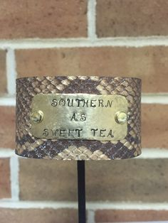 Southern as Sweet Tea Hand-stamped Snake print Leather Cuff by BlueWillowBracelets on Etsy https://www.etsy.com/listing/291928745/southern-as-sweet-tea-hand-stamped-snake