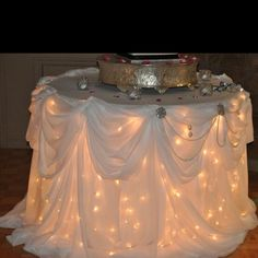 Lights under the reception table...Next time I get to throw, host or organize a shower or party I am doing this. Love it!