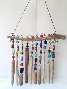 Incredible 47 Beautiful Beaded Wind Chime to Add Sparkle to The Garden http://godiygo.com/2017/11/24/47-beautiful-beaded-wind-chime-add-sparkle-garden/