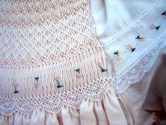 Close up of lace smocking design.