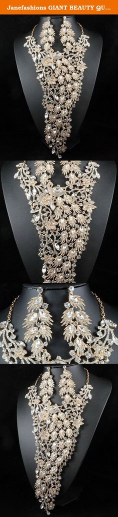 Janefashions GIANT BEAUTY QUEEN PEACOCK AUSTRIAN RHINESTONE NECKLACE EARRINGS SET N11935GC (Gold). You are looking at spectacular giant peacock necklace and earrings set. Sparkling first class Clear Genuine Austrian Rhinestones are heavily set on beautiful shiny Gold Tone metal. All rhinestones sparkle a lot! The center section hangs 10-3/8 inches! Wow! So gorgeous!! It is perfect for that special occasion. Thanks for looking!.