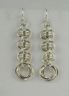 """These sterling silver earrings pair the barrell weave and mobius or rose chainmaille patterns for an elegant, long drop earring. Perfect with my """"orbital spin"""" bracelet!"""