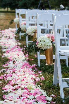 Gorgeous flower petals and arrangements at Spindletop Hall.   Photo by: Adam Padgett Weddings.    #ptopofthebluegrass #ptopweddings2016 #weddingflowers #weddingflowerpetals #weddingceremony #weddingdecor #weddingreception #outsideweddings