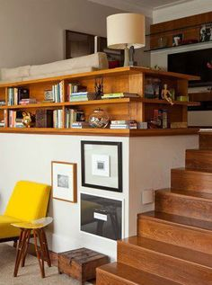 This wrap-around shelf not only creates more storage, but bridges two spaces and provides some visual interest to an awkward wall.