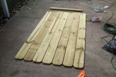 Fence Gate Buildinga Fence Gate Building 5 Ways to Cover up a Chain-Link Fence Stair Riser Vinyl Strips Removable Sticker Peel & From Dirt to Deck - How to Build a Ground-Level Deck Wood Fence Gates, Wooden Gates, Pallet Fence, Wire Fence, Ground Level Deck, How To Level Ground, Building A Wooden Gate, Chain Link Fence, Privacy Fences