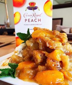 Crown Royal Peach Cobbler Preheat oven to And melt ½ stick of butter into a 13 by 9 Pyrex or casserole dish In a heavy saucepan, combine a can of peaches (undrained), ½ cup of sugar, ½. Peach Cobbler Cinnamon Rolls, Peach Cobbler Cake, Peach Cake, Peach Whiskey, Whiskey Girl, Scotch Whiskey, Irish Whiskey, Peach Drinks, Bourbon Drinks