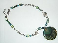 Peacock Necklace with Glass and Shell Beads and Handmade Chain Links. $31.00, via Etsy.