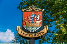 The Tenterden town sign depicting a galleon on the open sea with sails displaying the coat of arms of the cinque ports which are 3 heraldic lions that merge into 3 long boats. Asian History, British History, Historical Women, Historical Photos, Strange History, History Facts, Chapel Down, Bodiam Castle, Tree Restaurant