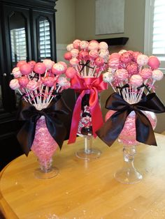 Cake pops (or Lollipops) in jars are stuck in styrofoam balls. The balls are surrounded by candies or Easter basket colored grass. With beautiful bows to finish the look.