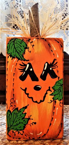 Pumpkin Block Sitter combines Country Charm with a Primitive Flair! The Pumpkin Block with Wood Stem & Raffiafeatures a Hand Painted Block and Hand Decorated Accenting. Fall Wood Crafts, Halloween Wood Crafts, Halloween Painting, Fall Halloween, Wooden Pumpkin Crafts, Halloween Canvas Paintings, Scarecrow Painting, Halloween Blocks, Wood Block Crafts