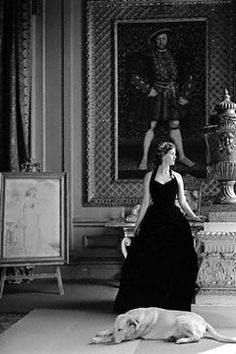 Deborah, Duchess of Devonshire, in the Gold Drawing Room at Chatsworth beneath a Holbein portrait of Henry VIII. Photo by Norman Parkinson, 1952.