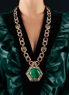 costume jewelry by decade -   BOLD 70'S  Yves Saint Laurent vintage silk taffeta blouse. Bulgari 18k yellow gold, emerald, ruby, and diamond necklace.      Read more: http://www.wmagazine.com/accessories/2012/11/jewel-decades-shop-the-look-ss#ixzz2KEdOpPqW