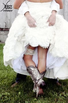 """""""showing off garter and country boots - scandalous bride and groom picture"""" absolutely love this!!"""
