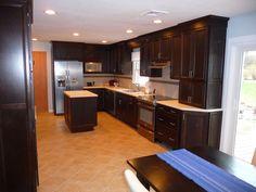 kitchen remodel, tile floors, island, L-shaped counter tops, linear glass back splash accent, tile back splash